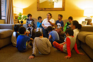 Mama Diana leads the boys in a devotional time.