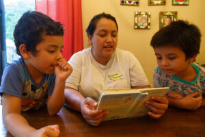 Mama Diana reading to boys at Dorie's Promise