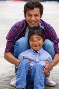 Miguel with Brayan, many of the older boys miss Miguel like a brother.