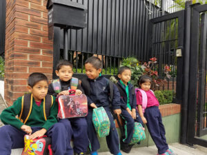 Children from Dorie's Promise lined up and waiting for their ride to school.