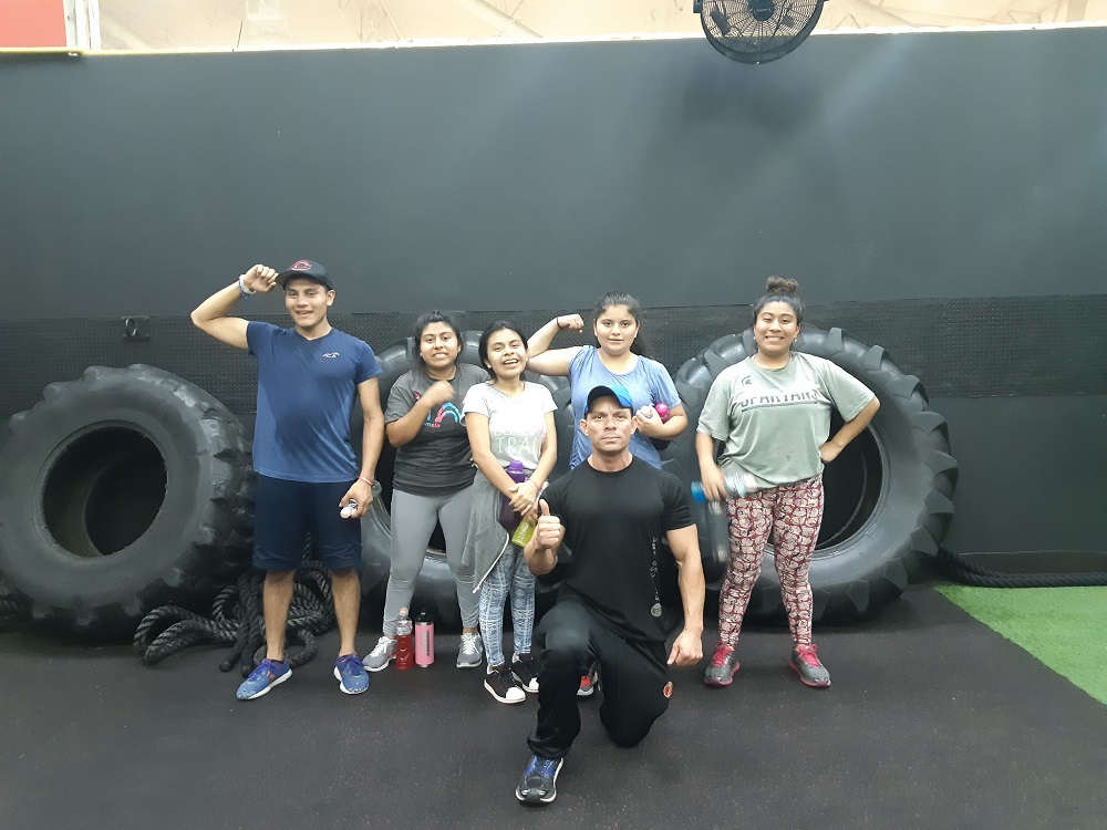 Kids from Dorie's Promise with their trainer at the gym.