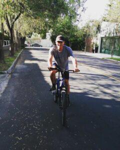 Brayan on his bike near Dorie's Promise.