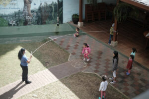Children playing outside at Dorie's Promise