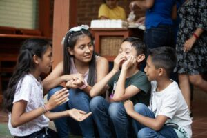 Flor at Dorie's Promise with some other children