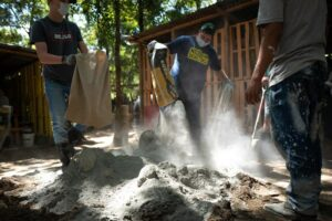 A mission team works on a community project